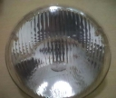 "HEAD LAMP UNIVERSAL, HELLA 7"" SEAL BEAM."